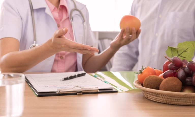 Nutritionist consulting with her client